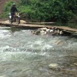 Crossing a bamboo bridge in Northeast Vietnam