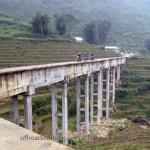 Dirt bike ride in Mai Chau on a small and high irrigation bridge